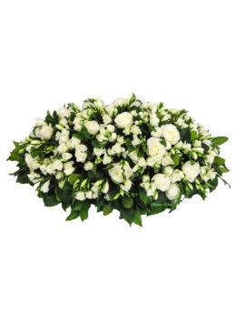Groot rouwbloemstuk met fresia's